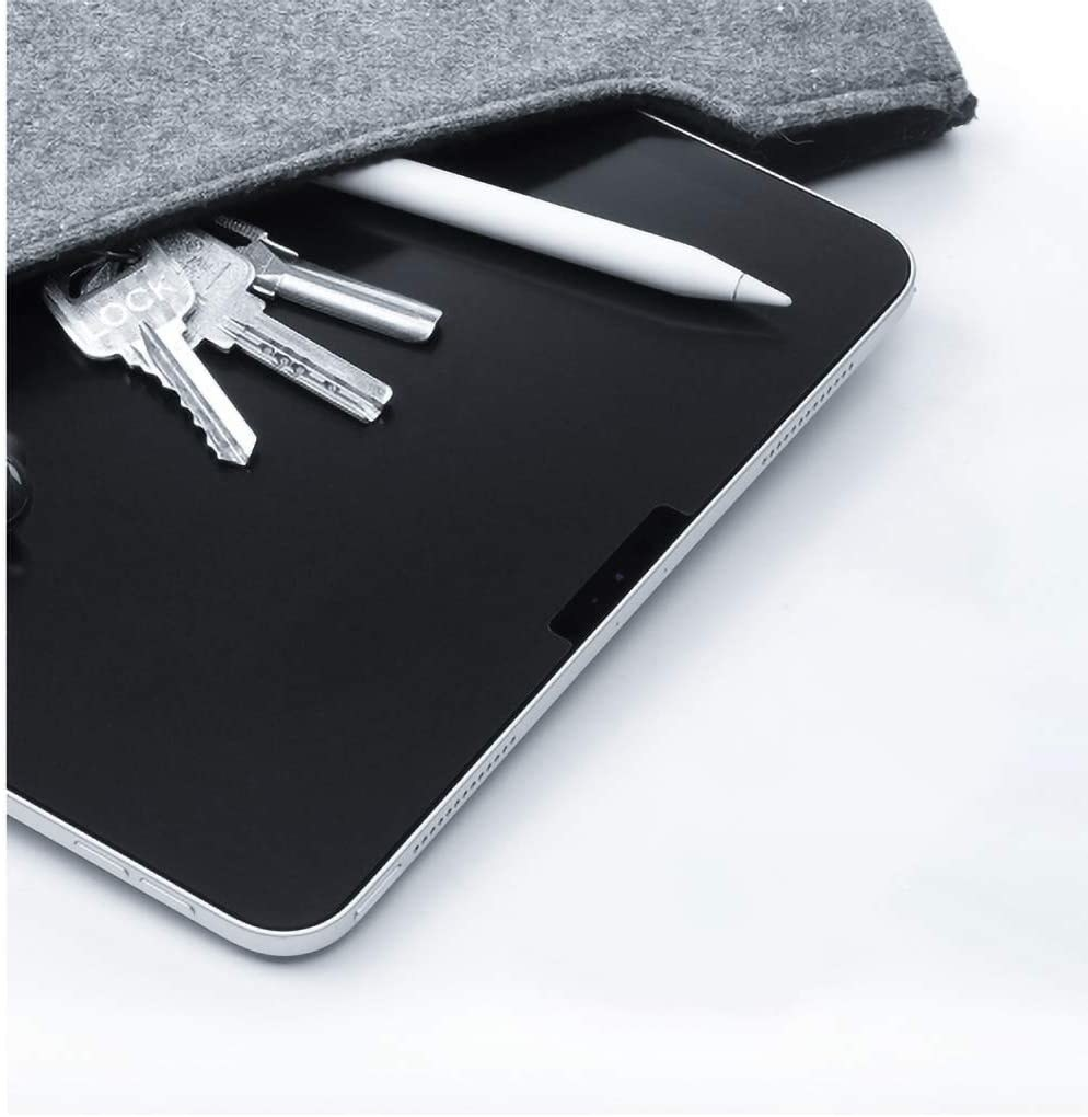 matte screen protector coming out of a case with keys and a drawing pencil