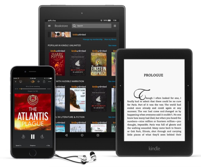 books on a phone and two different sized kindles