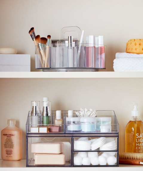 bathroom medicine cabinet shelves organized with acrylic storage containers