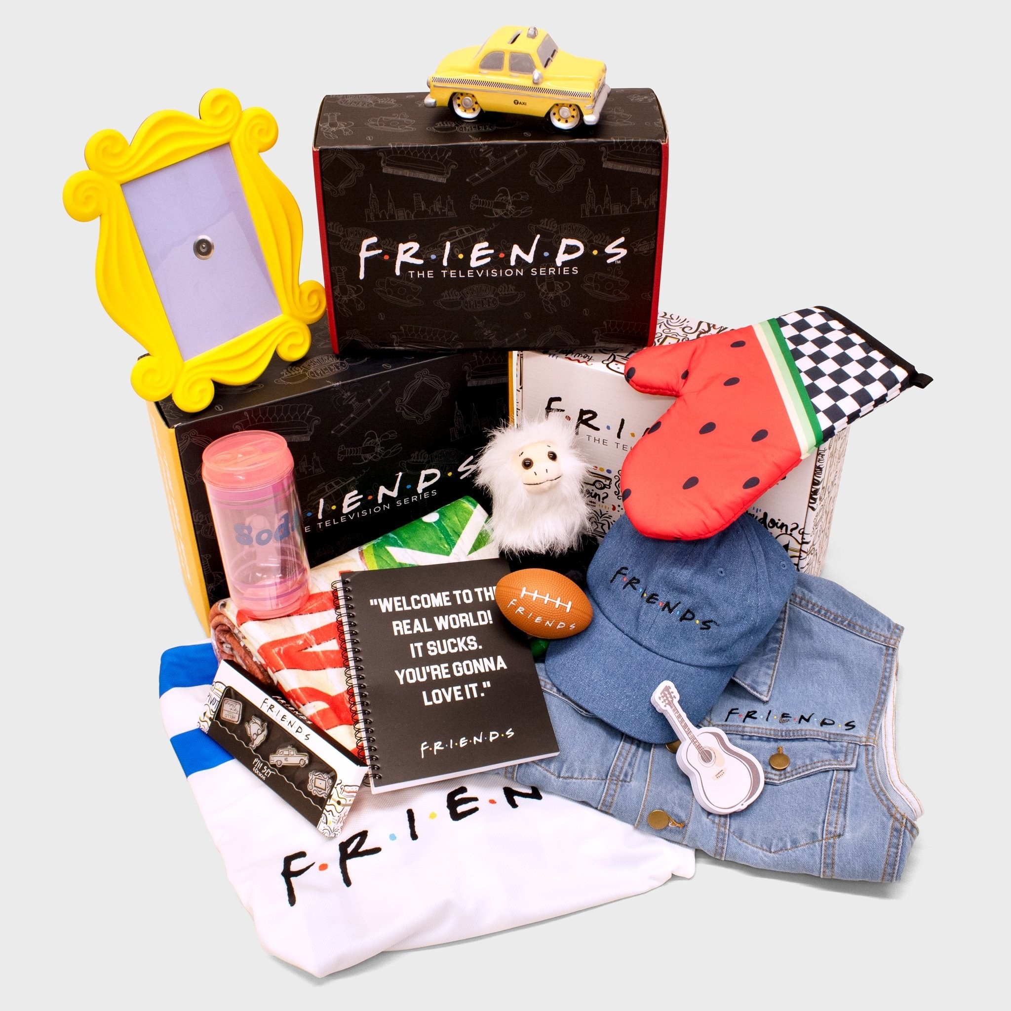 the box filled with merchandise from the show Friends