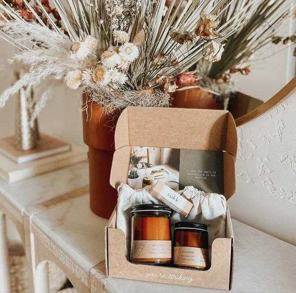 subscription box with two candles in it