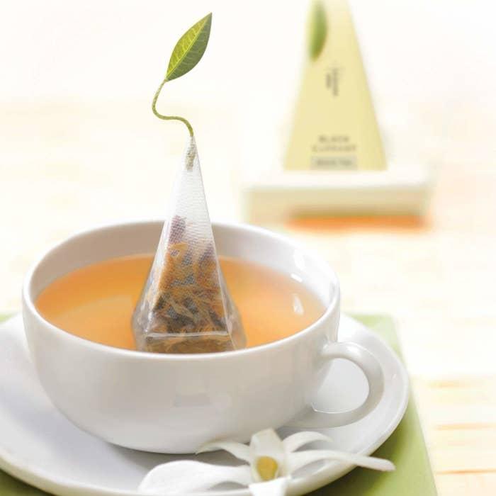 pyramid-shape tea bag in a cup of tea