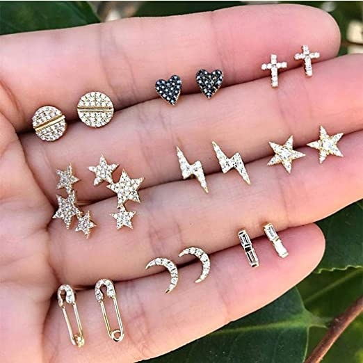 open palm with various small earring studs