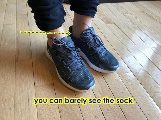 Reviewer wearing sneakers to show how the sock stays hidden