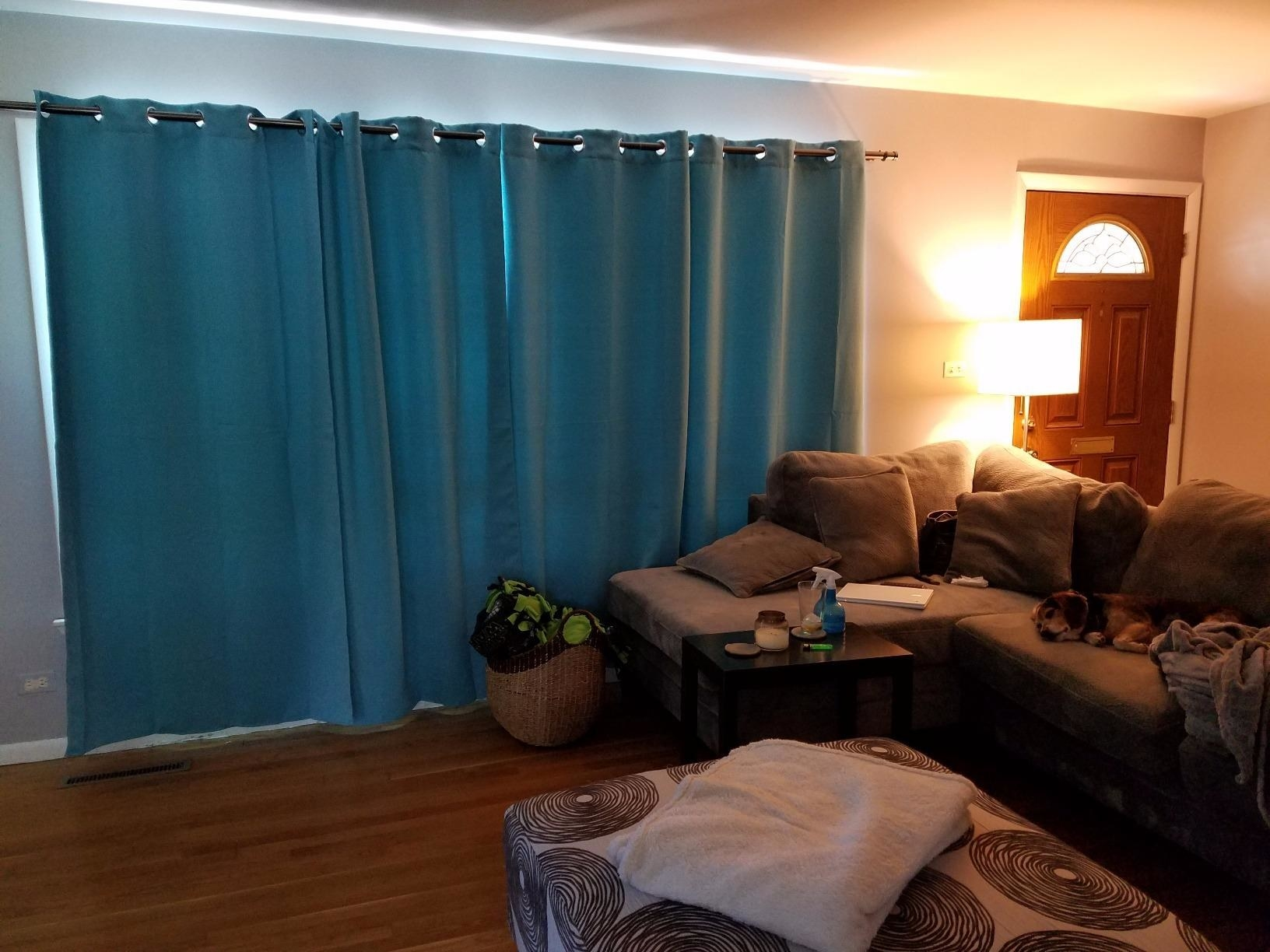 reviewer photo of blue curtains in their living room
