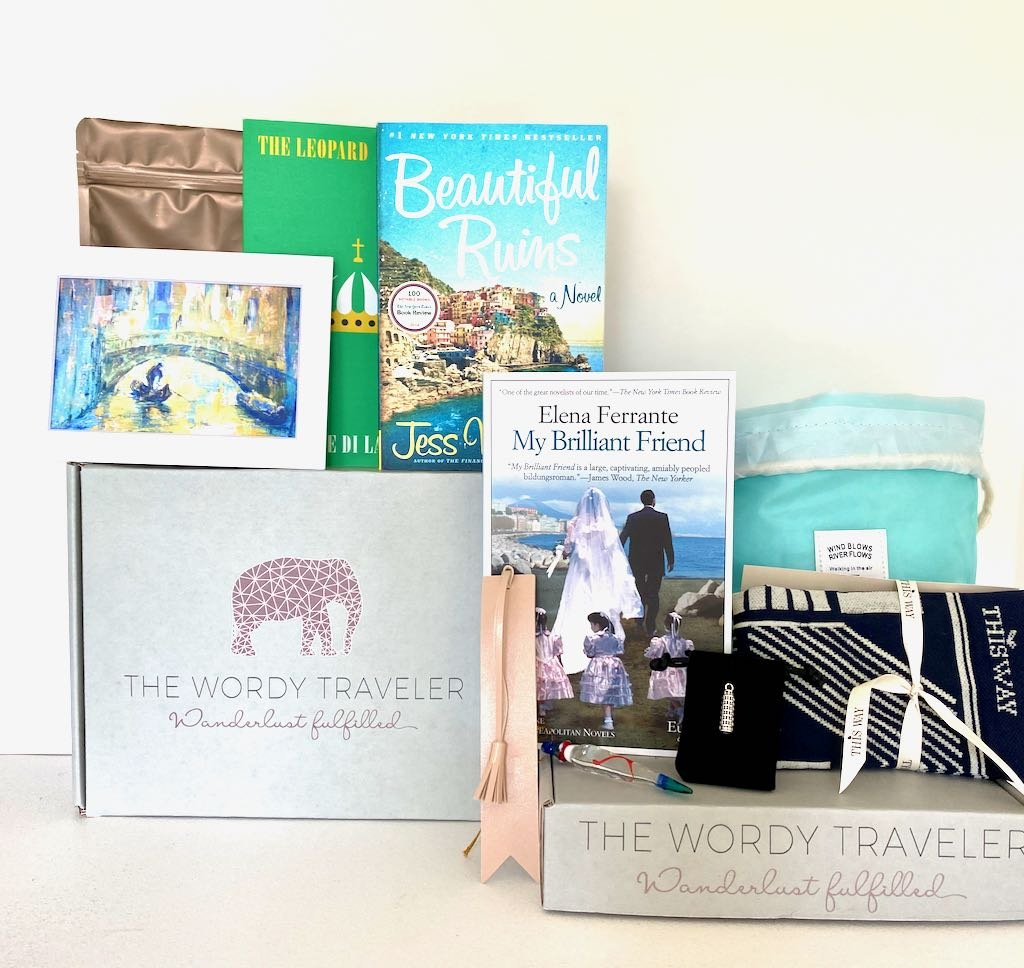 the wordy traveler box that comes with books and other knick knacks