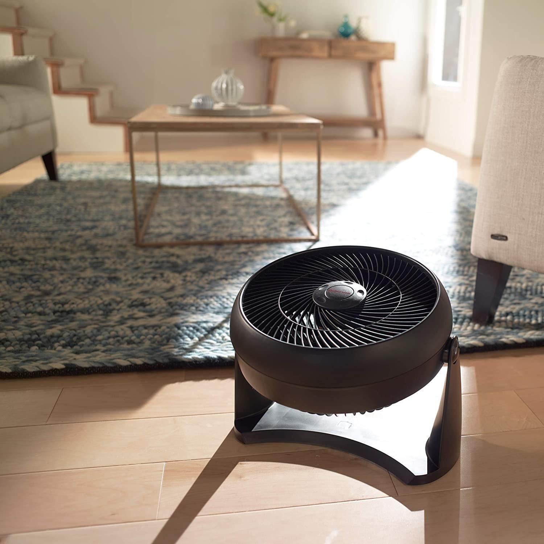Honeywell circulator fan on the floor of a living room