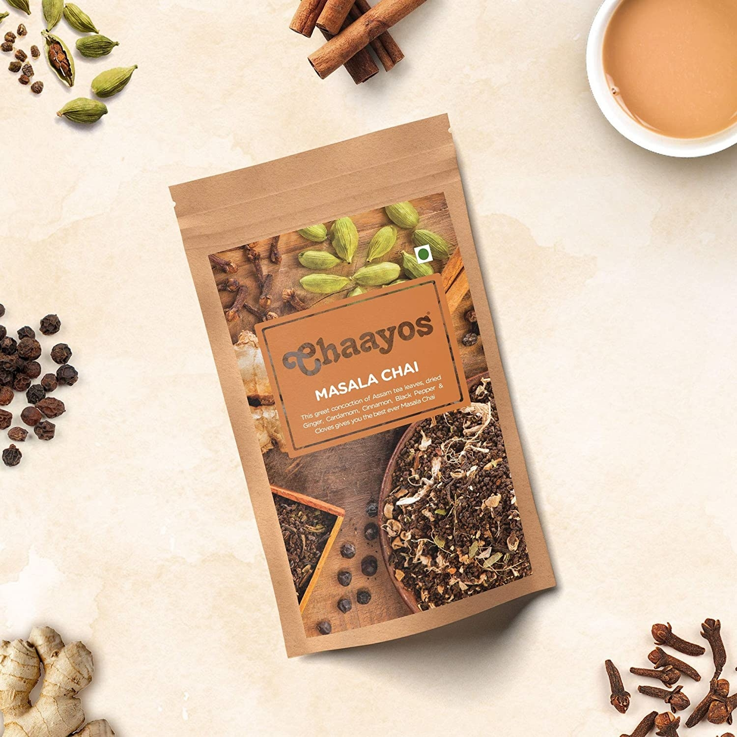 Packet of Chaayos masala chai on a table surrounded by spices