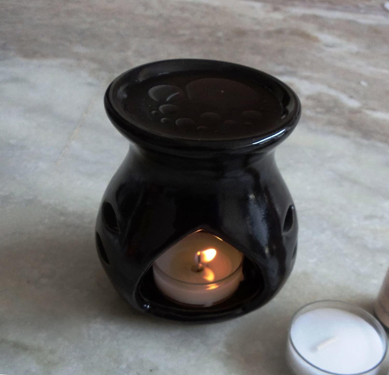 A ceramic candle burner