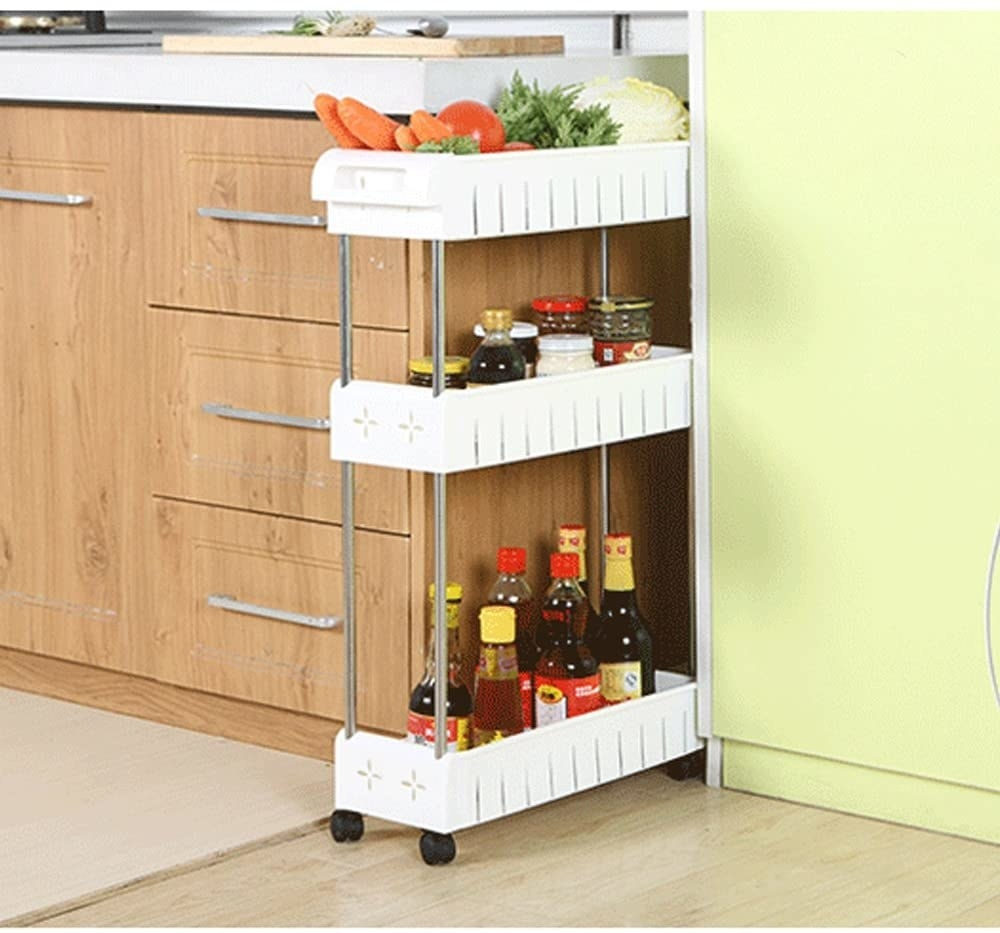 The roll-out shelf with oils, spices, and food on it