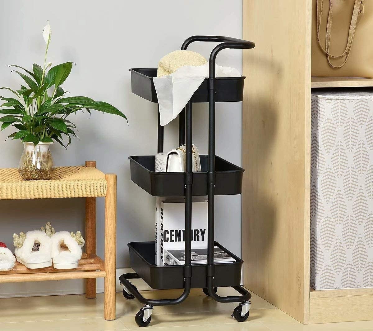 The utility cart beside a shoe bench and a shelf