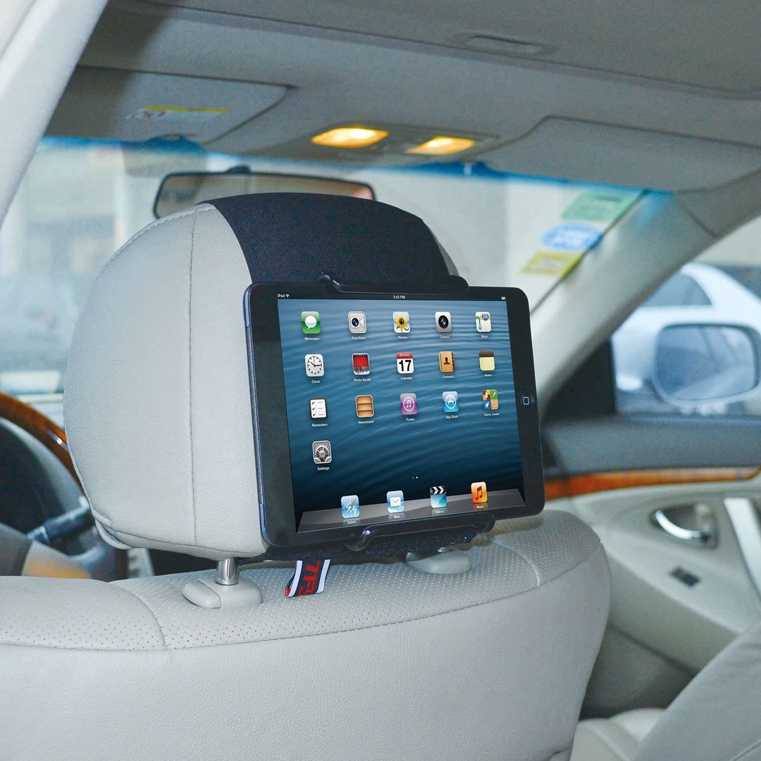 A tablet clipped into the headrest holder