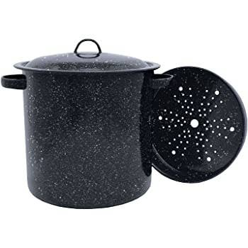 A photo of a large black granite colored tin steamer pot