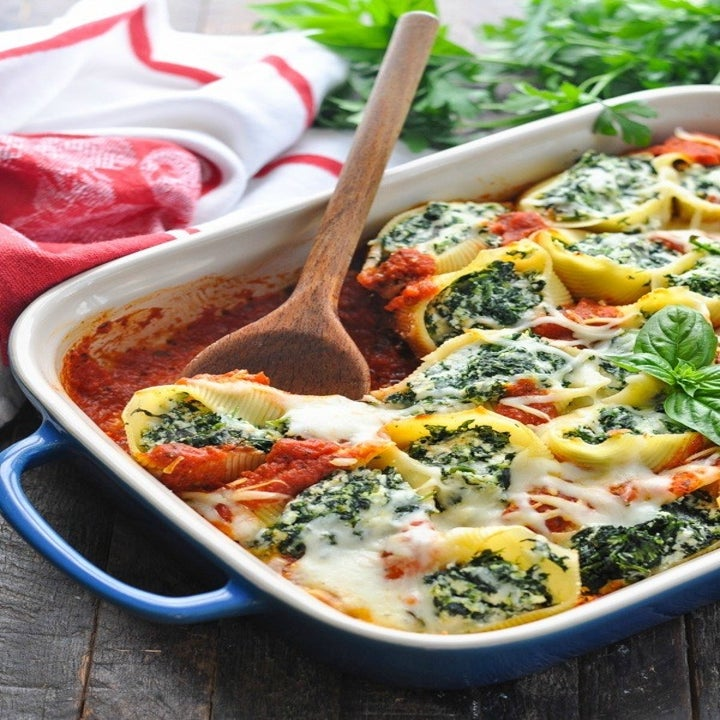 Cheesy, spinach-stuffed shells in tomato sauce.