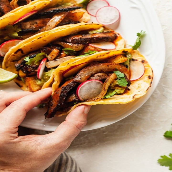A plate of vegetable tacos.