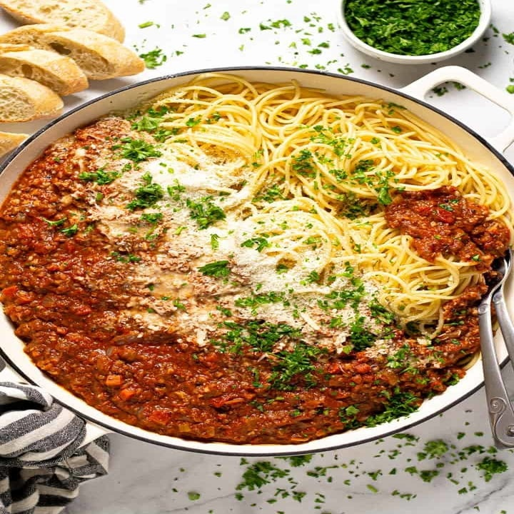 Spaghetti in meatless Bolognese sauce topped with Parmesan and herbs.