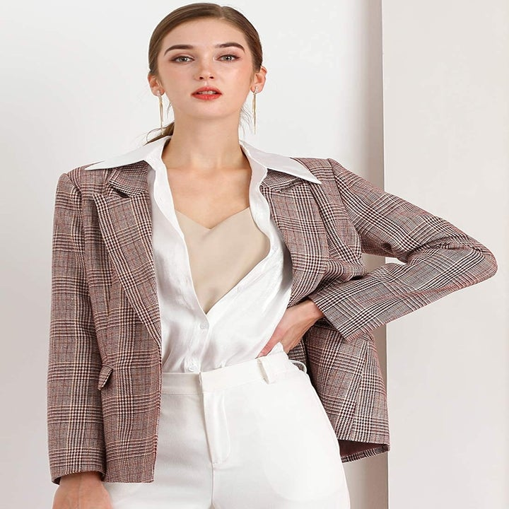 A model wearing the burgundy plaid blazer