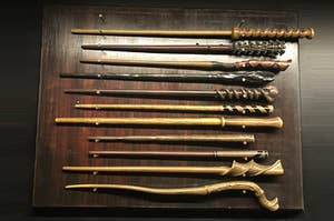 A table full of various magical wands