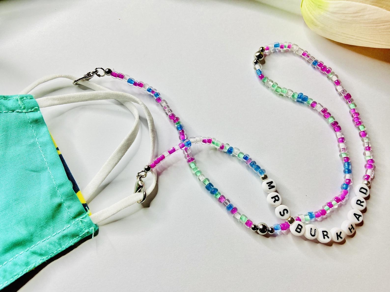 purple, blue, and green beaded mask chain with personalized letter beads