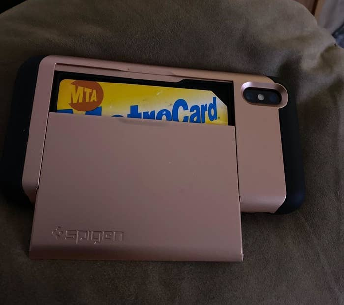 reviewer photo showing pink Spigen card case with metro card in it