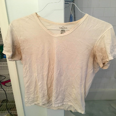 White undershirt with armpits stained brown and most of front a darker, sweat-stained color