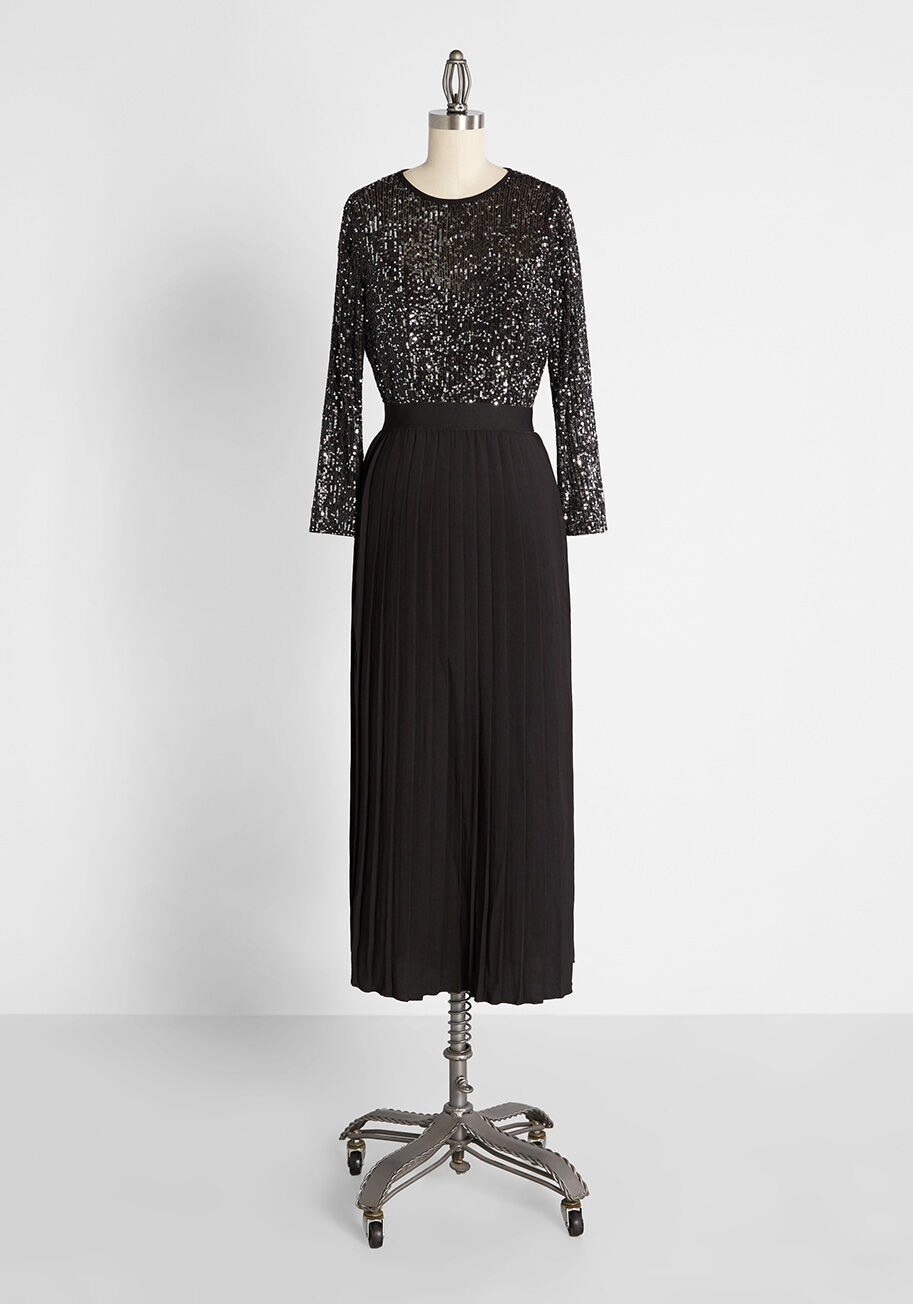 The black maxi dress with glittery long-sleeve top half