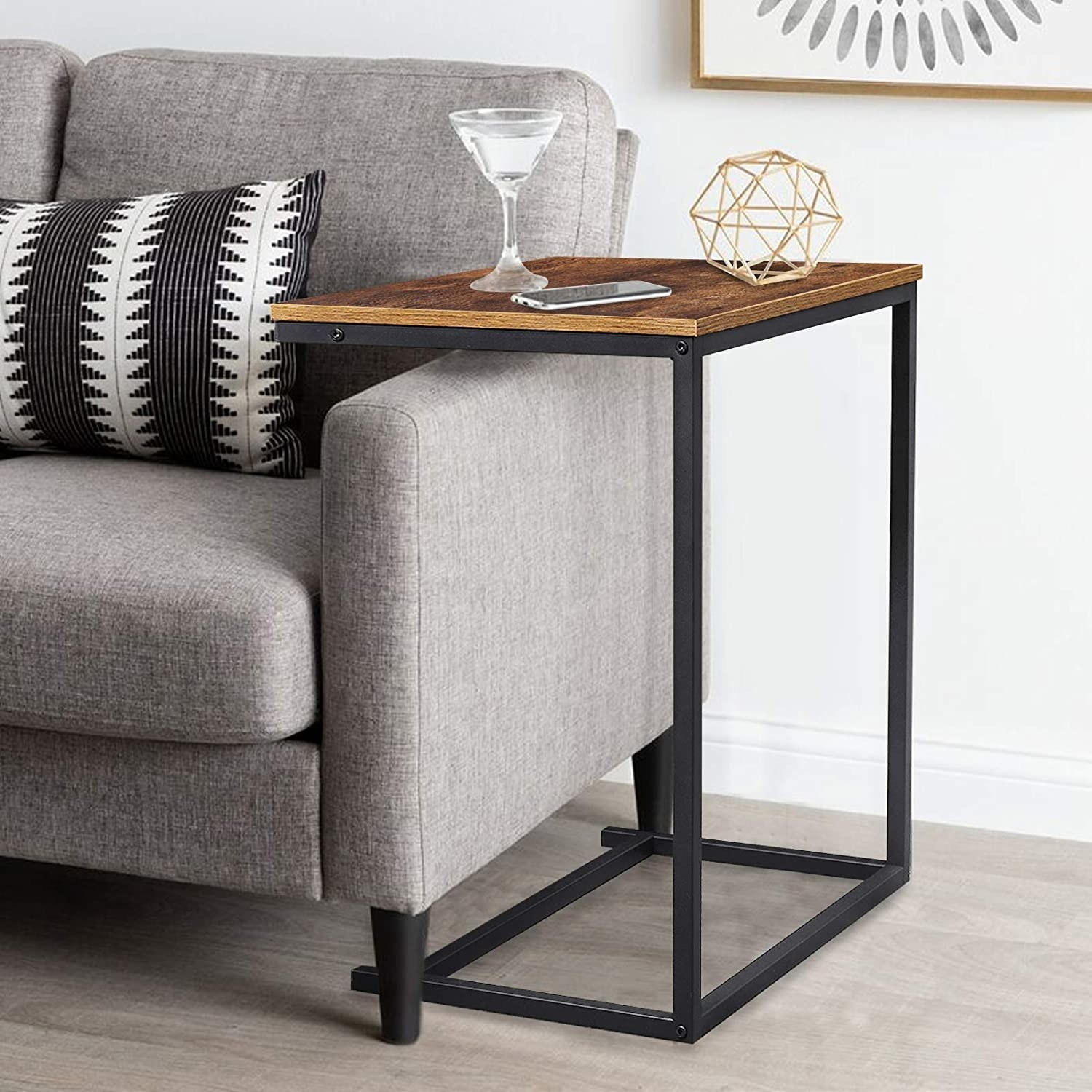 The vintage wooden C-shaped table