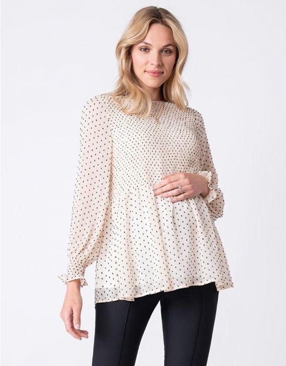 model wears maternity blouse