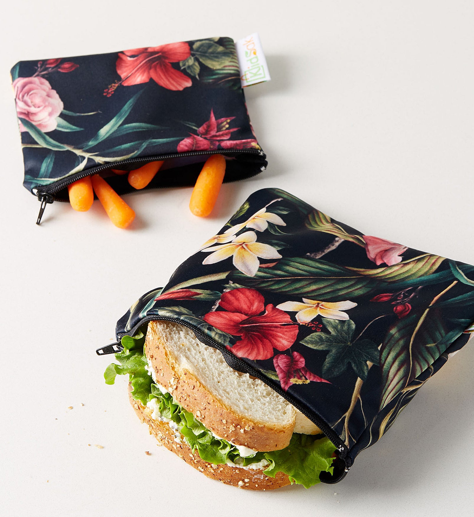 Two floral pouches with snacks inside