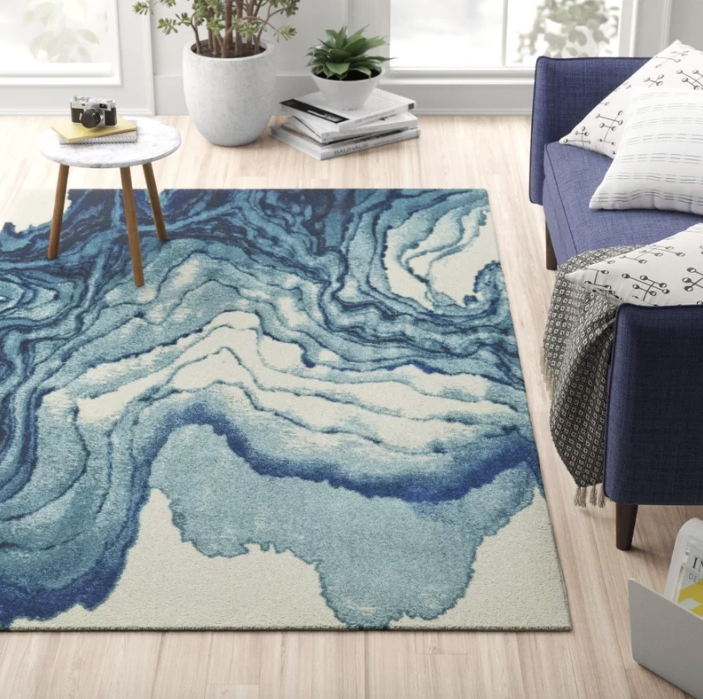 the rug with a blue watercolor design in a living room setting
