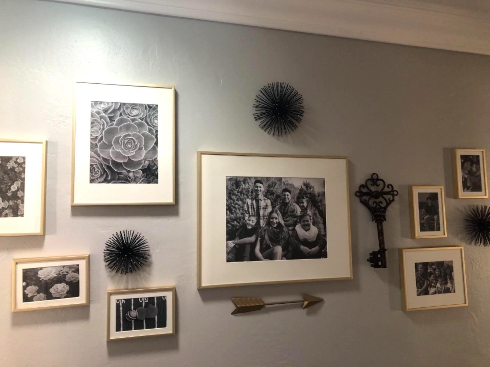 Reviewer image of their gallery wall using the gold frames