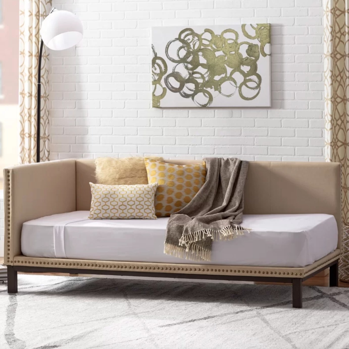 The metal mid century day bed in tan
