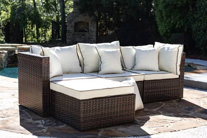 the patio sectional in brown with cream cushions