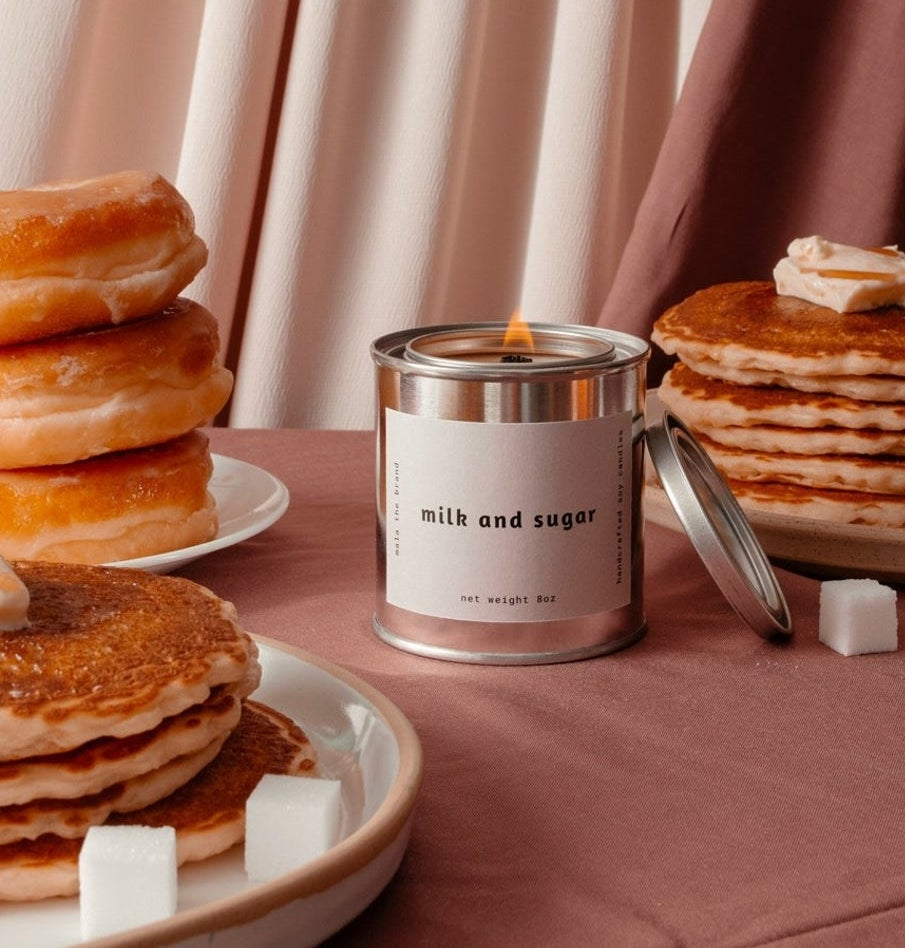 The candle surrounded by pancakes and donuts