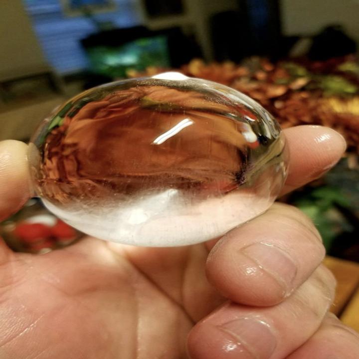 Customer holding sphere ice cube