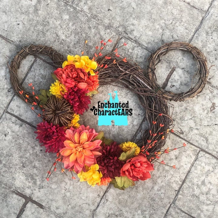 a mickey-shaped wreath with fall florals on it