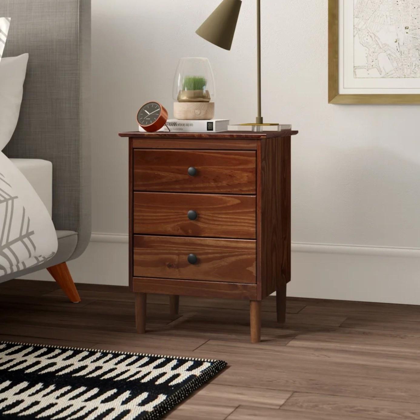 The three drawer nightstand in walnut