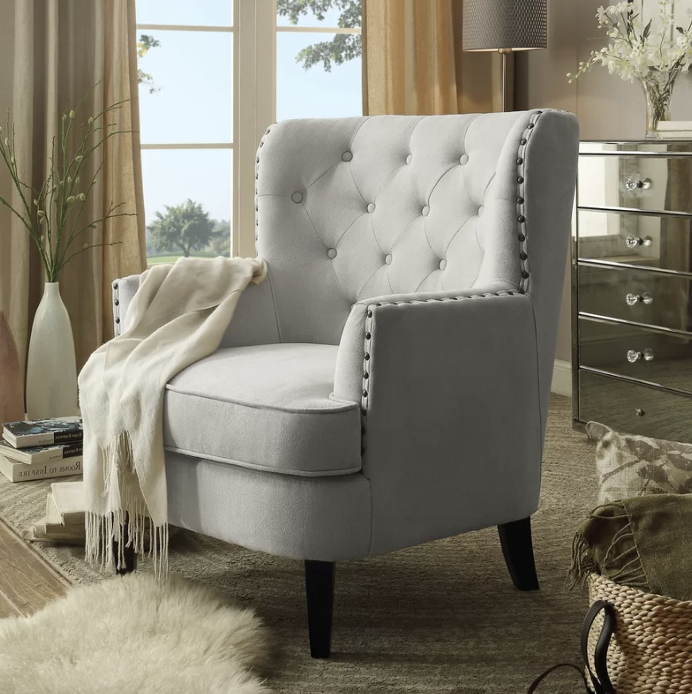 the chair in grey with a blanket draped over it