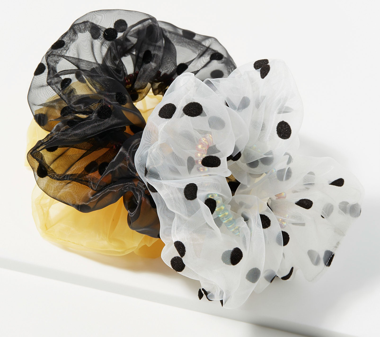 Three tulle scrunchies in a pile