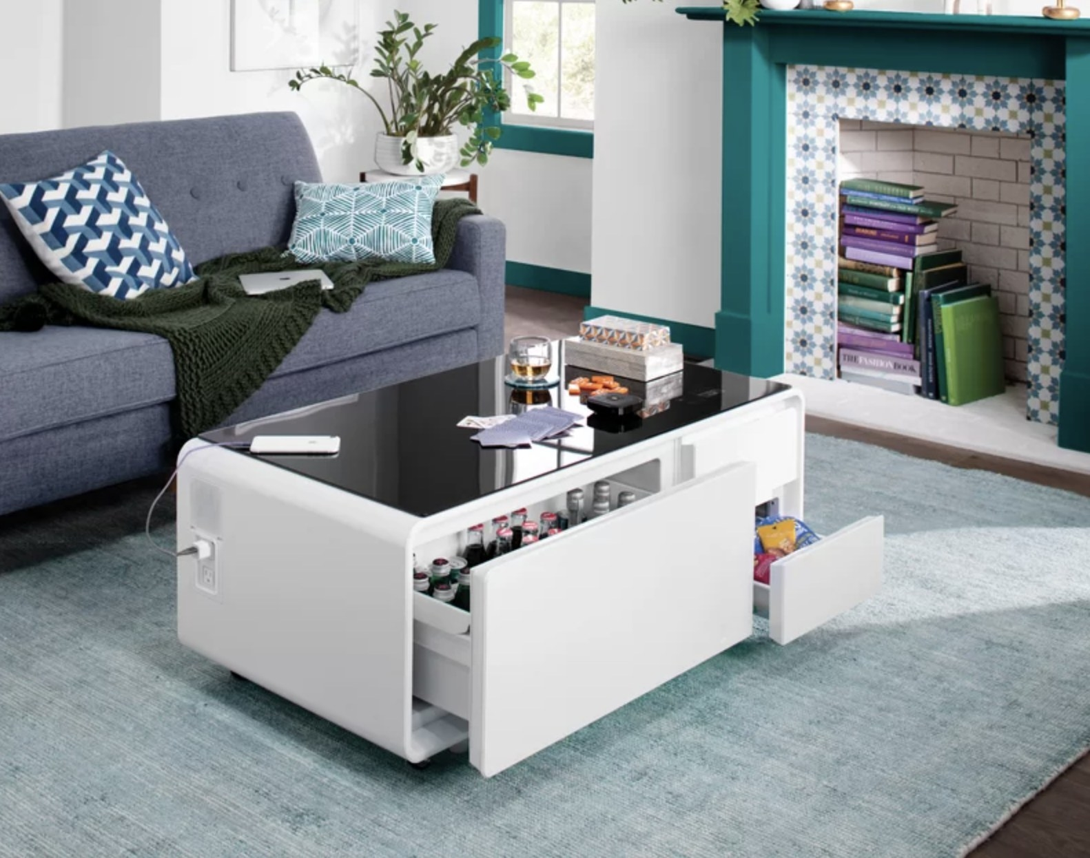 the coffee table shown with the drinks inside the fridge drawer, the two outlets on the side, and the two drawers for storage