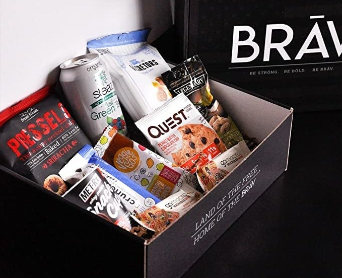 An open box filled with a mix of heathy snacks