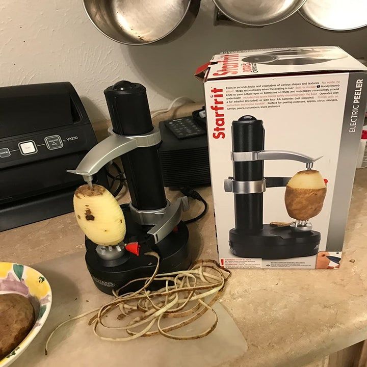 Black peeler machine on kitchen counter