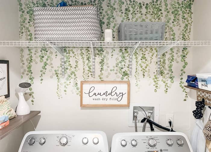 reviewer image of the roommates string of pearls vine decals on a laundry room wall
