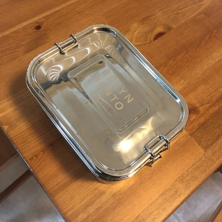 """The stainless steel bento box that reads """"BKLYN Bento"""" on the lid"""