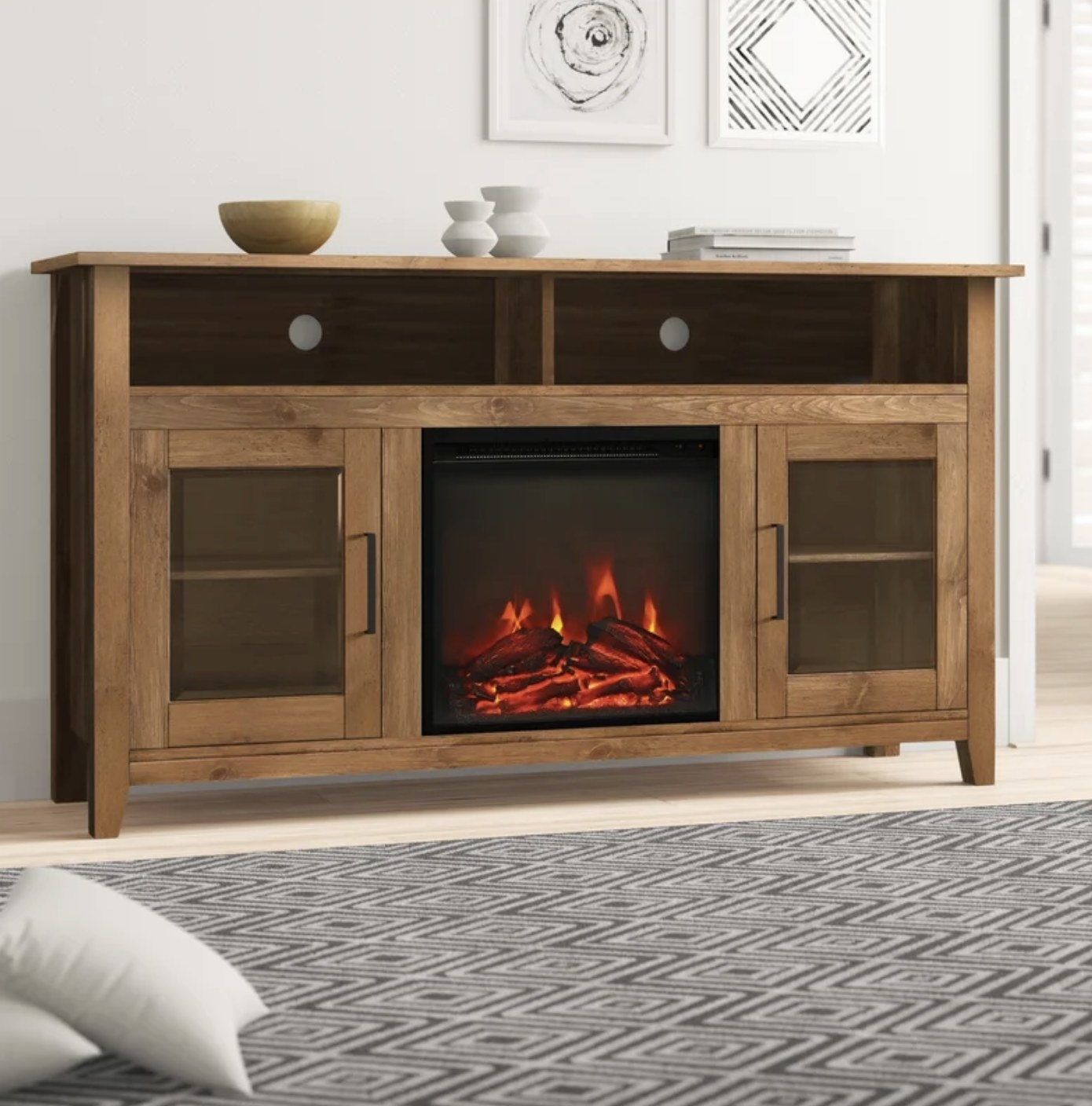 the tv stand in barnwood with the fireplace lit up