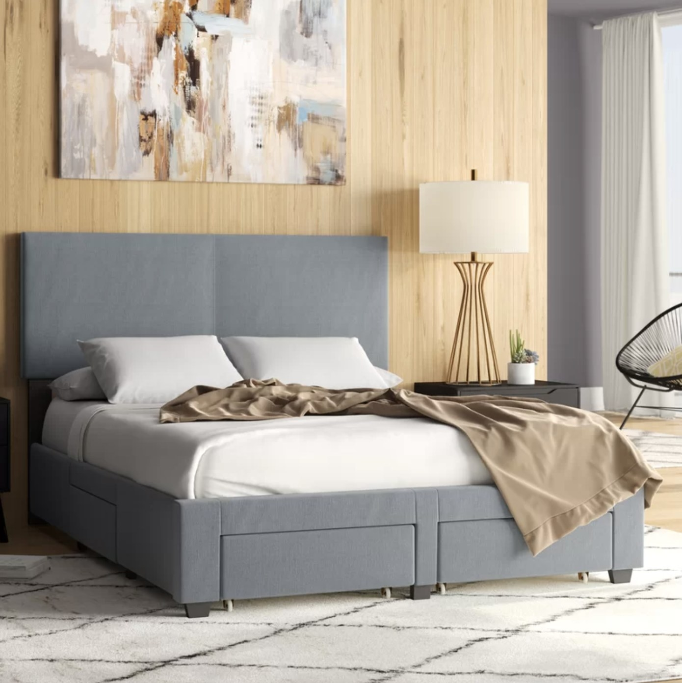 the bed frame in a gray color with three of the drawers displayed