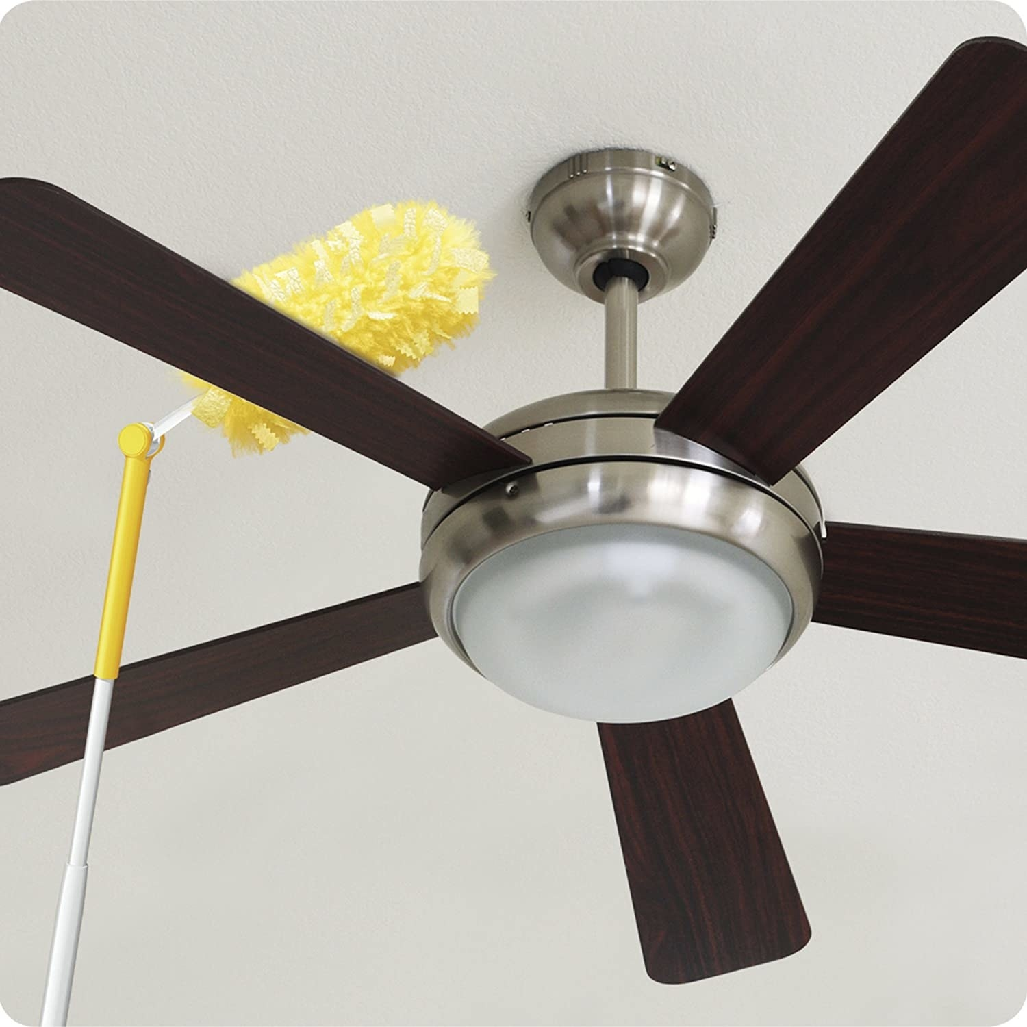 the duster being used to clean a ceiling fan