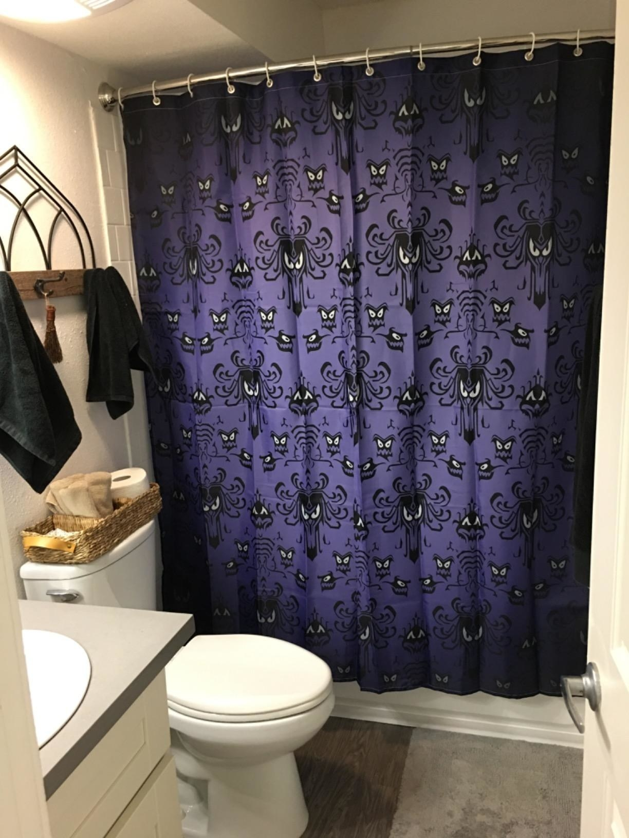 the iconic purple wallpaper from the haunted mansion as a shower curtain