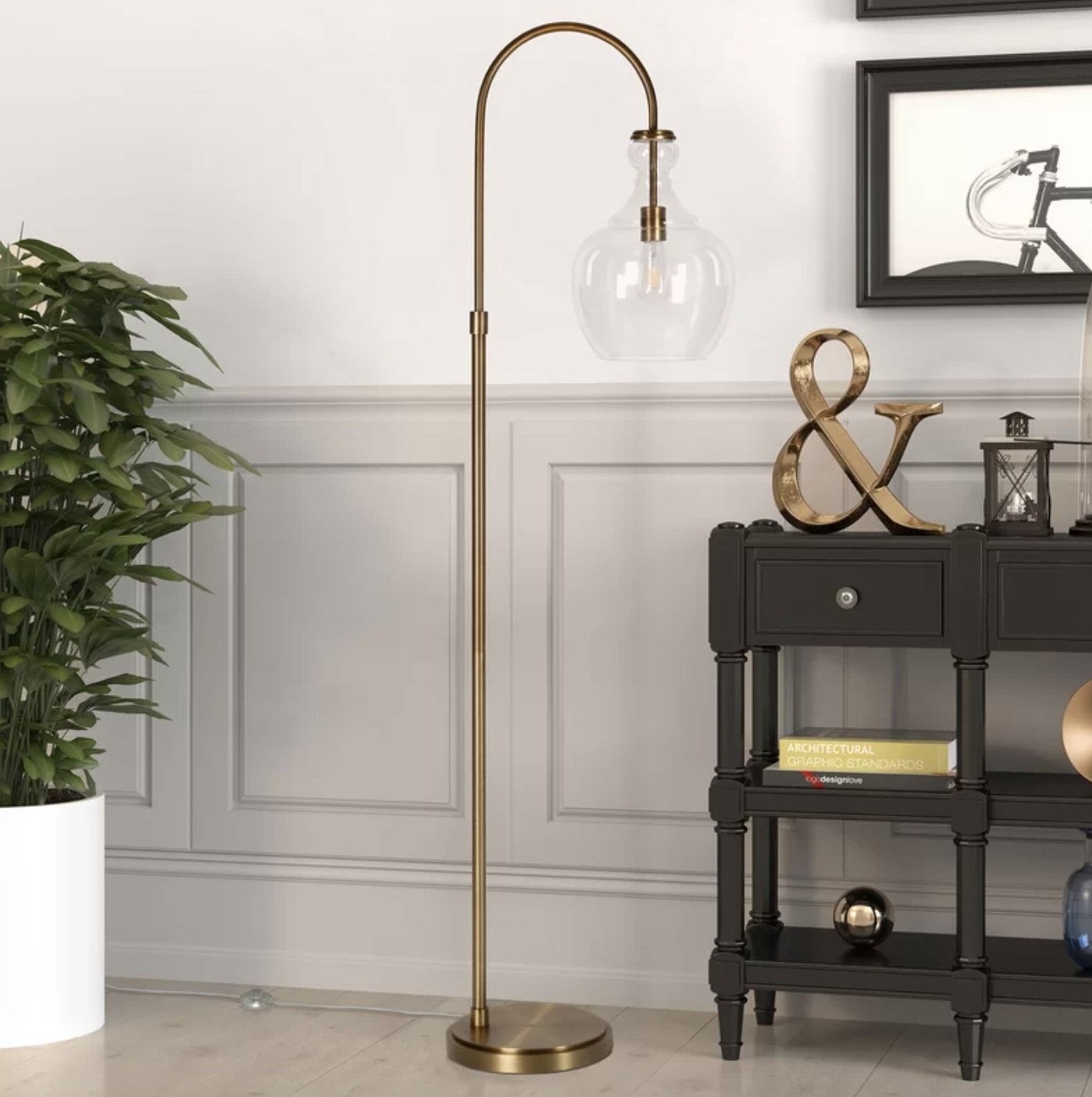 the lamp in brushed brass with a clear glass
