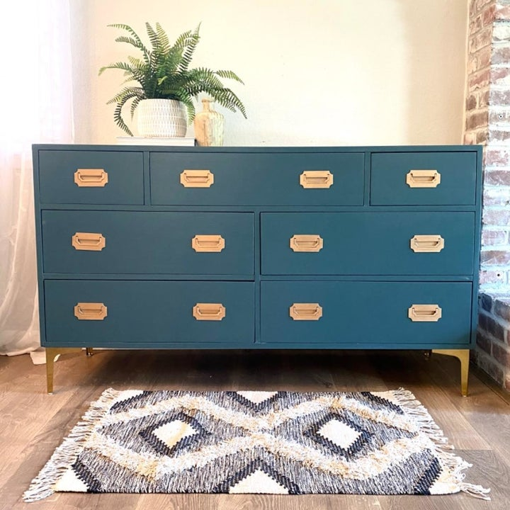 Same reviewer showing a full shot of their dresser with the gold feet